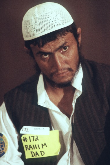 Rahim, an Afghan guerrilla, listens during a press conference at the San Bernardino Community Hospital. The conference is being held so that he and his three compatroits can tell their story about the war with the Soviets and their subsequent injuries. The guerrillas are here in the United States to receive medical treatment for those injuries.