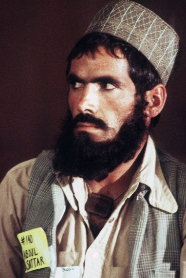 Abdoul, an Afghan guerrilla, listens during a press conference at the San Bernardino Community Hospital. The conference is being held so that he and his three compatriots can tell their story about the war with the Soviets and their subsequent injuries. The guerrillas are here in the United States to receive medical treatment for those injuries.