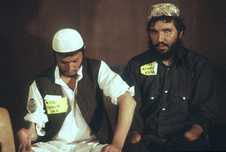 Rahim and Rehmat, Afghan guerrillas, listen during a press conference at the San Bernardino Community Hospital. The conference is being held so that they and their compatriots can tell their story about the war with the Soviets and their subsequent injuries. The guerrillas are here in the United States to receive medical treatment for those injuries.