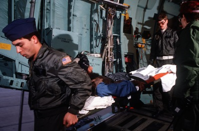 Medics from the 2nd Aeromedical Evacuation Squadron remove wounded Afghan freedom fighters from a C-141B Starlifter aircraft. The freedom fighters are being transported to the Wiesbaden Regional Medical Center for an overnight layover while en route from Pakistan to the United States for treatment.
